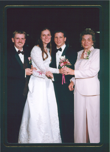 Chad, Becky, Blair and mom (Hazel).  Picture with the people who caught the bouquet and garter.