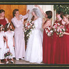 Becky surrounded by the bridesmaids, mom and the flower girls before the wedding.<br /> (left to right) Nicole (flower girl), Danielle (flower girl), Laura Ames (sister in law), Hazel Ames (mom), Becky, Phyllis Sleight (sister), Brandi Sleight (niece), Alyse Reamy (sister-in-law to be)