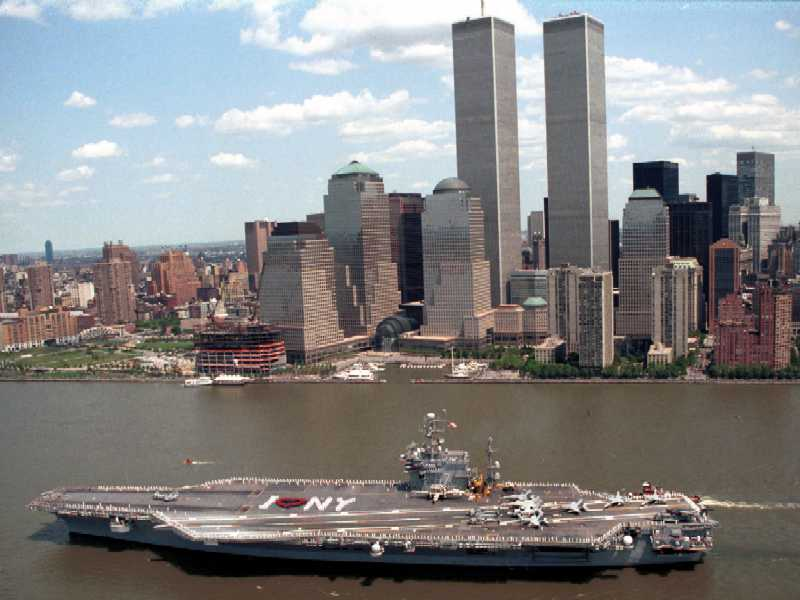 U.S.S. JFK going through New York City and in front of the Twin Towers.