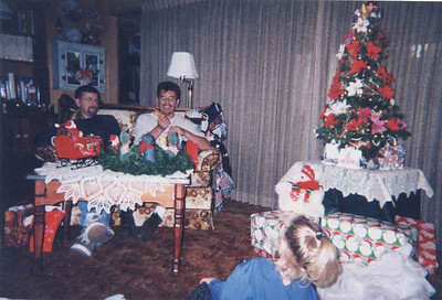Christmas day opening gifts. Joe and Gary are visiting with us and Paige is watching to see what Joe has.