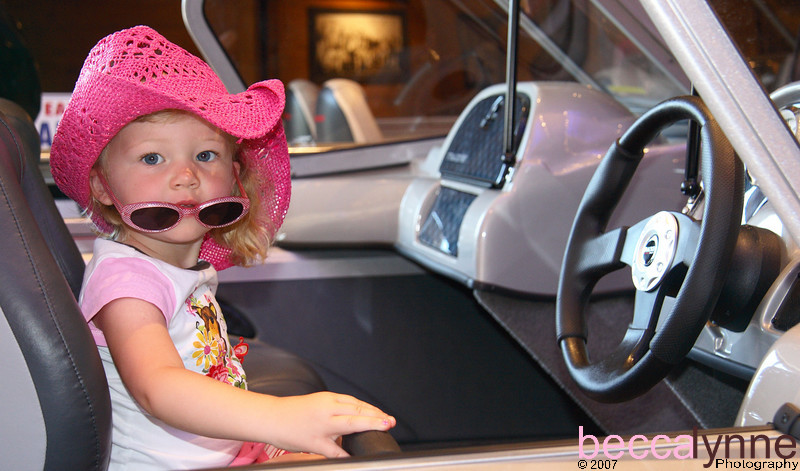 Amelia checking out the boats at Bass Pro Shop
