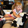 Amelia making sure that Big Cow is sitting safely in the seat before she takes off in her new Bass Boat.