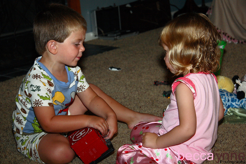 When Amelia finally arrived at the house, Landon was one of the first boys to greet her.  He wanted to show her all his toys.  Here they pulled out Landon's cars and played nicely together for about two hours.  Bedtime was 10:00 PM