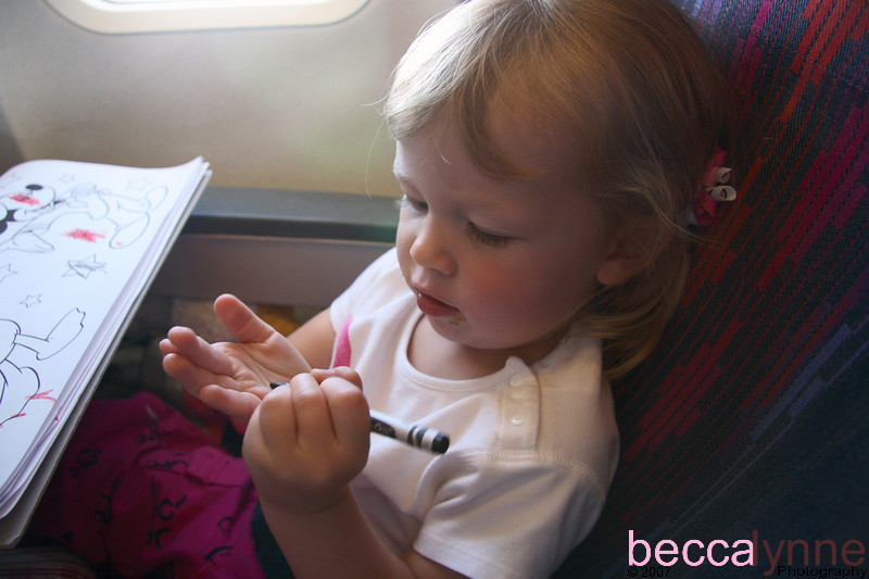We finally made it onto the plane and she decided to take out her new Mickey Mouse coloring book.