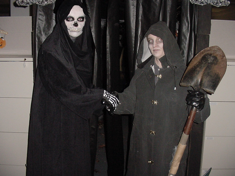 Becky as death and Heidi as a grave digger.