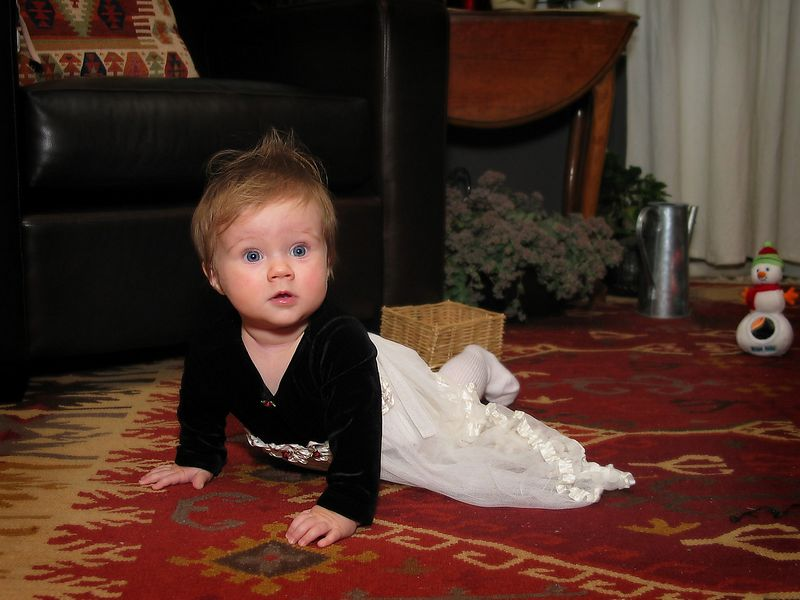 12/24 - Lili is crawling in her first dress