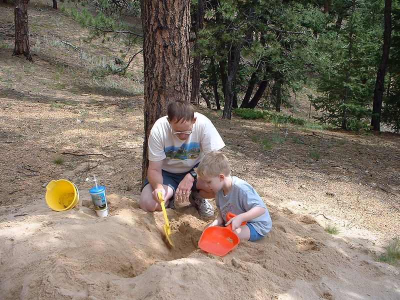 Uncle Richard and Thomas play in the sand at Grandmothers house in Coloado.