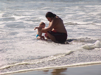 Playing with child on beach