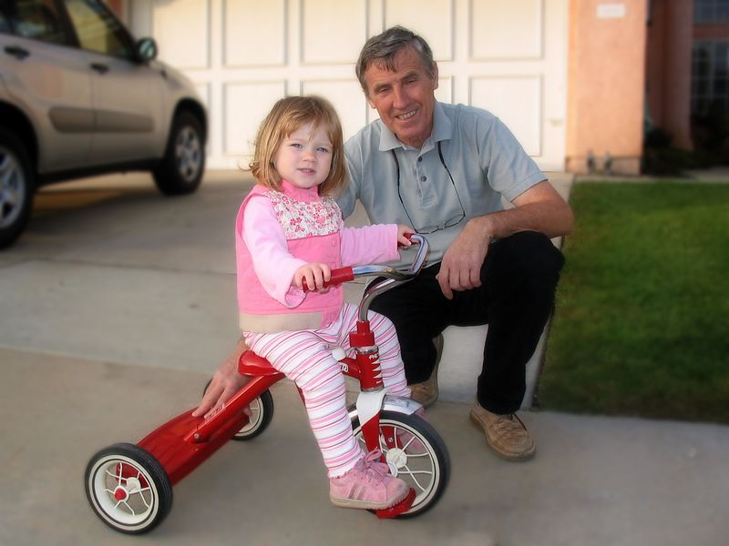 11/20 - Otto's dad is teaching Lili how to ride her tricycle