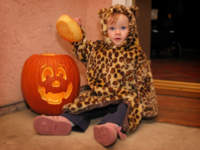 10/31 - Lili just loves pumpkins! Adel carved this one.