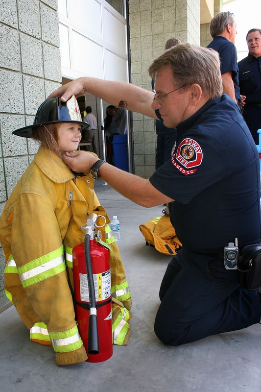 10/15 - Open day at the Poway Fire Station. Lili is being dressed up for a picture