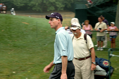 Jim Furyk and Fluff head to the prictice range.....