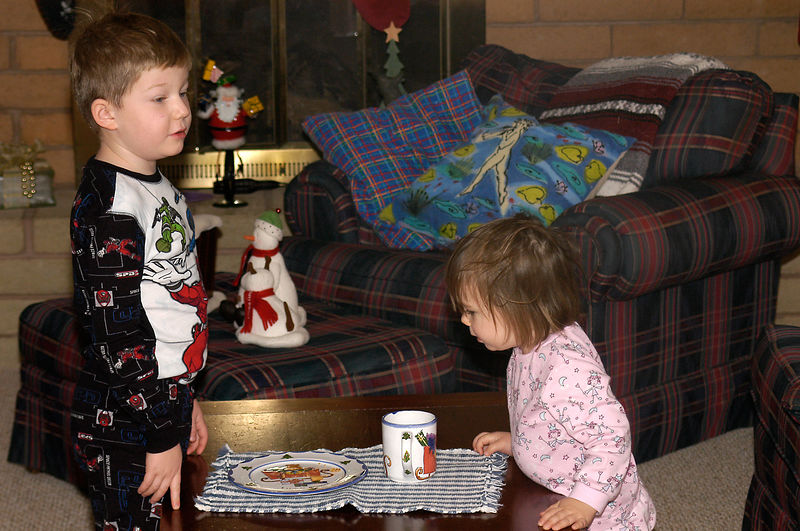 "(12.25.2005)  ""Wow, Santa did eat the cookies and drink the milk."""