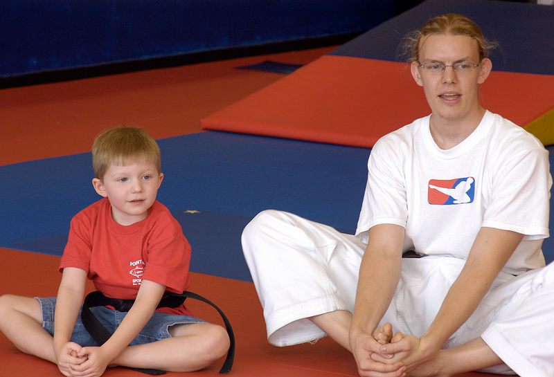 (8-13-05)  Connor and Mr. Hodges show how to stretch.