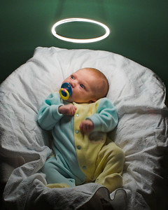 """""""Our Little Angel""""  With binky in mouth, it took 62 exposures to get this one. The binky was what was able to keep K.C. pacified as Dad whirled a mini-maglite on a string above his head. We had to strike a fine balance between camera exposure time vs. time without fidgeting. (8x10 crop)"""