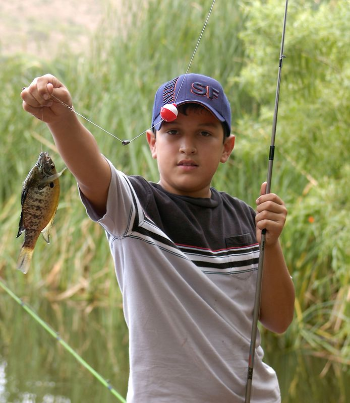 7-23-2005 -- Isaac with a trophy Bluegill.