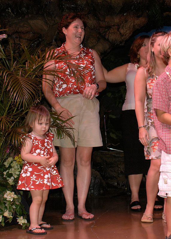 (11.11.2005, Maui, HI)  Claire and Mom on stage learning how to dance the Hula at a Luau.