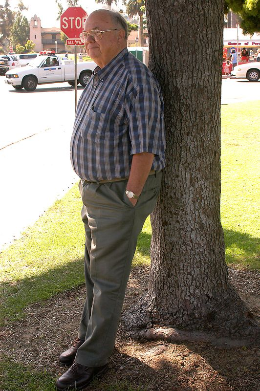 May 29, 2005 -- Grandpa holding up a tree in Balboa Park.