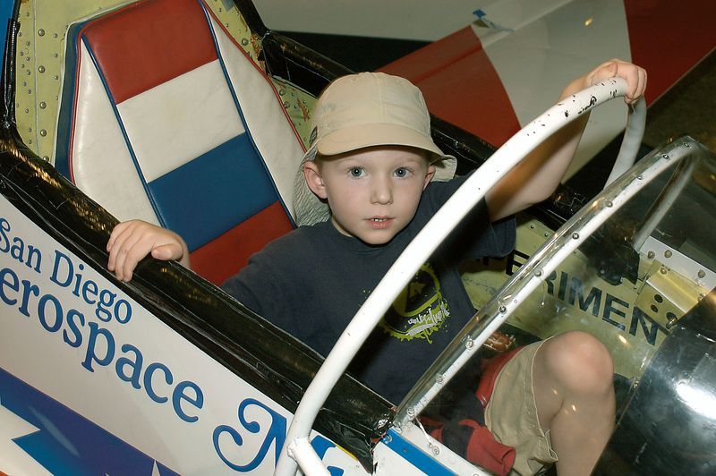 May 29, 2005 -- Connor getting out of a flight simulator at the San Diego Aerospace museum.