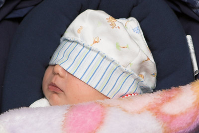 Back from the car ride.  Mom & Dad figured out that the brim of the hat needed to be turned up for better, or any, visibility.  K.C. didn't care as he slept through the whole event.
