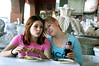 (12.26.2005)  Gigi and Martina enjoying lunch at a taco stand in Sonyta, MX on the way to Rocky Point.