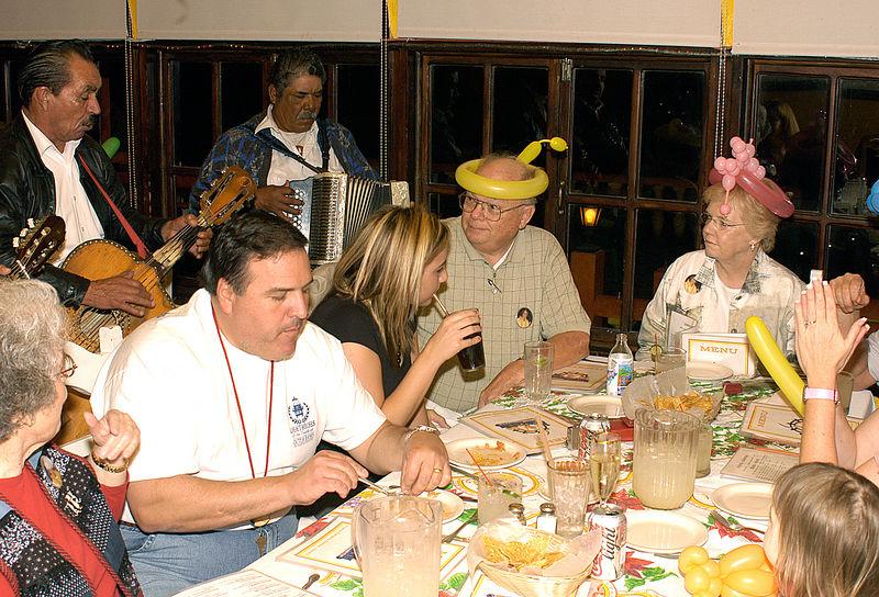 (12.27.2005)  The Birthday Girl getting serenaded.