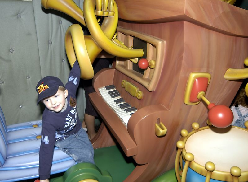 Connor playing with Mickey's piano.
