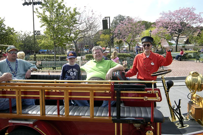 Connor and Dad ride the Disneyland Firetruck.