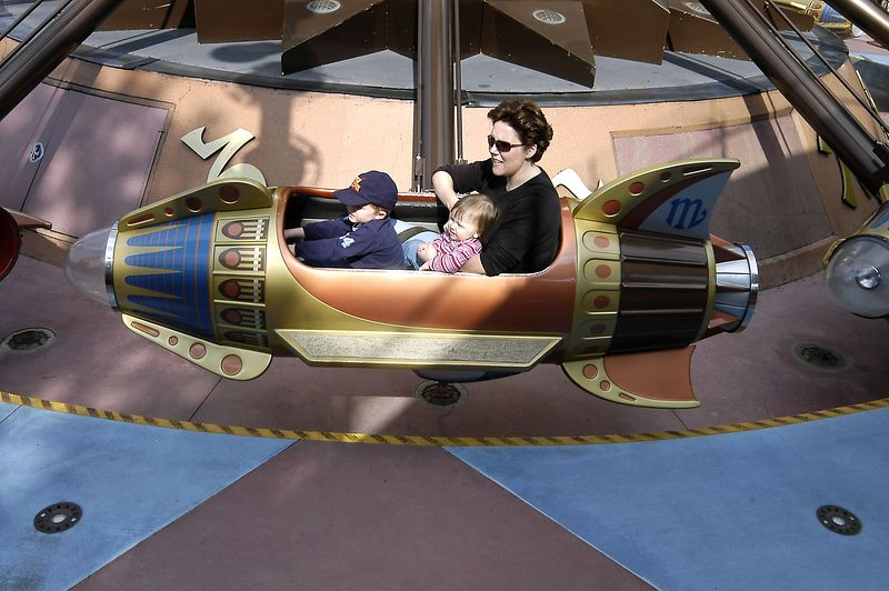 Claire, Connor and Mom getting ready to take off on the Rocket Ship ride at Disneyland.