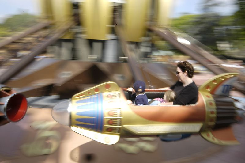 Claire, Connor and Mom zoom around in the Rocketship ride at Disneyland.