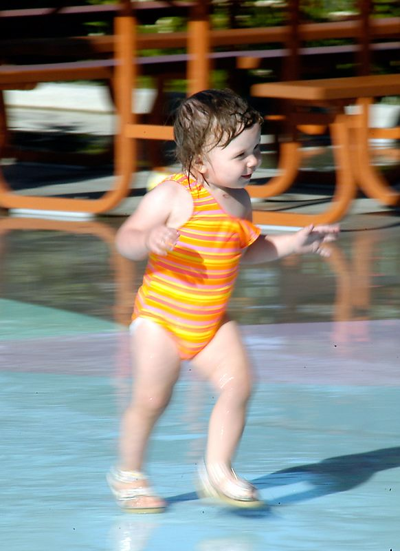 6-30-2005 -- Claire in motion at the water park at Bonfante Gardens.