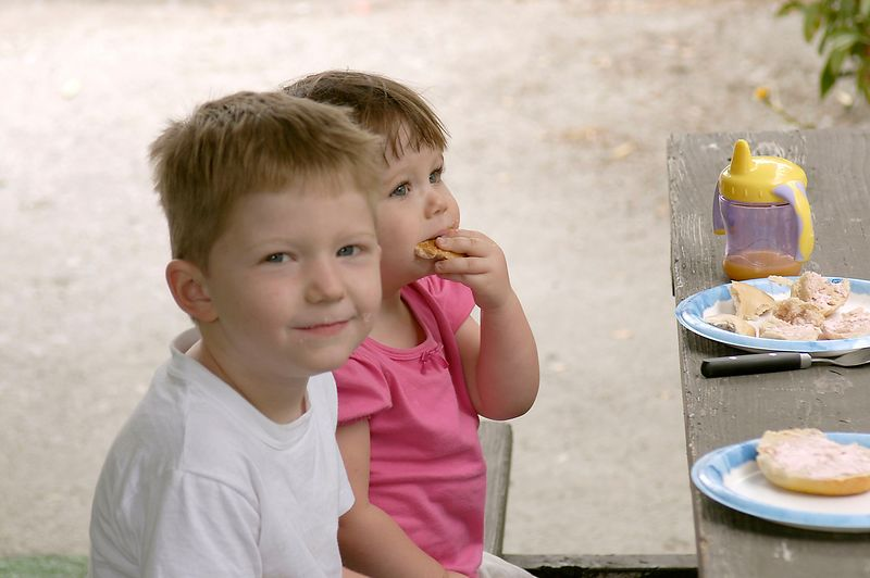6-27-2005 -- Connor and Claire enjoying a camp breakfast.