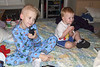Thomas and Stephen have fun playing on the big bed with the walkie-talkies.