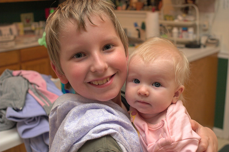 Josh holds Chloe while Mom blows out her birthday candles.<br /> August 4th, 2006