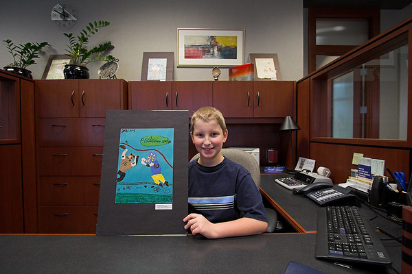 Joshua at a local bank, where his art is displayed for one month.