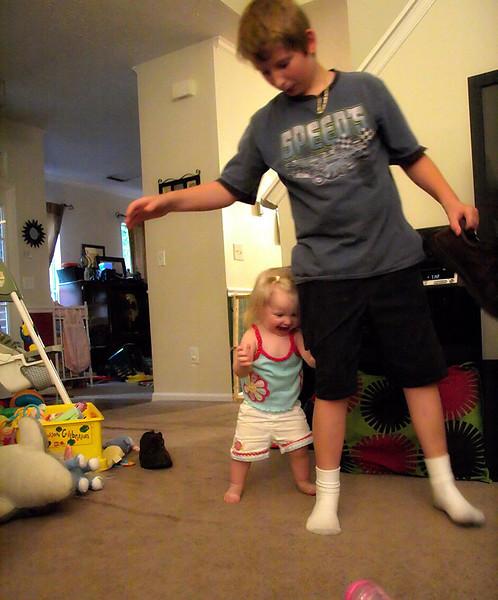 Walking while holding on to Josh.