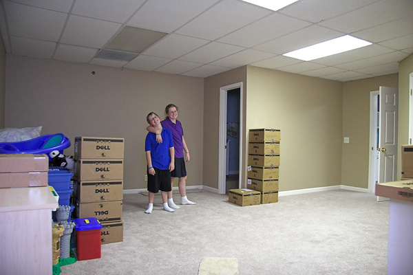 The playroom in the basement. Bathroom with shower in the corner.  Door on right leads to media room.