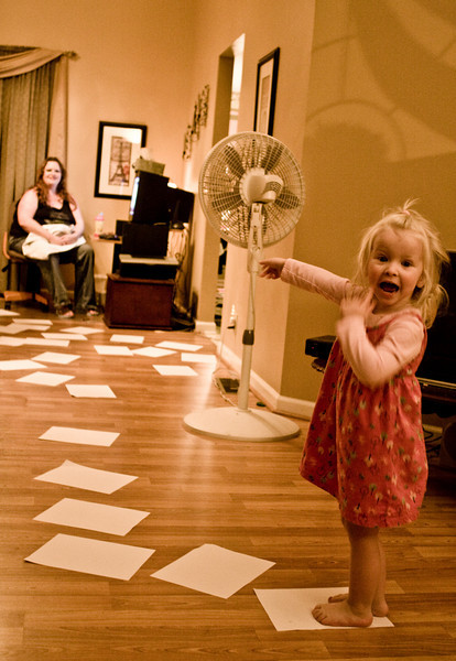November 15, 2008 - Chloe grabbed a pile of papers from the printer and started to spread them on the floor.  Dad one-upped her by spreading even more around and making a path across the living room.  Chloe ran and ran and ran, around and around.  Dad took 132 pictures.