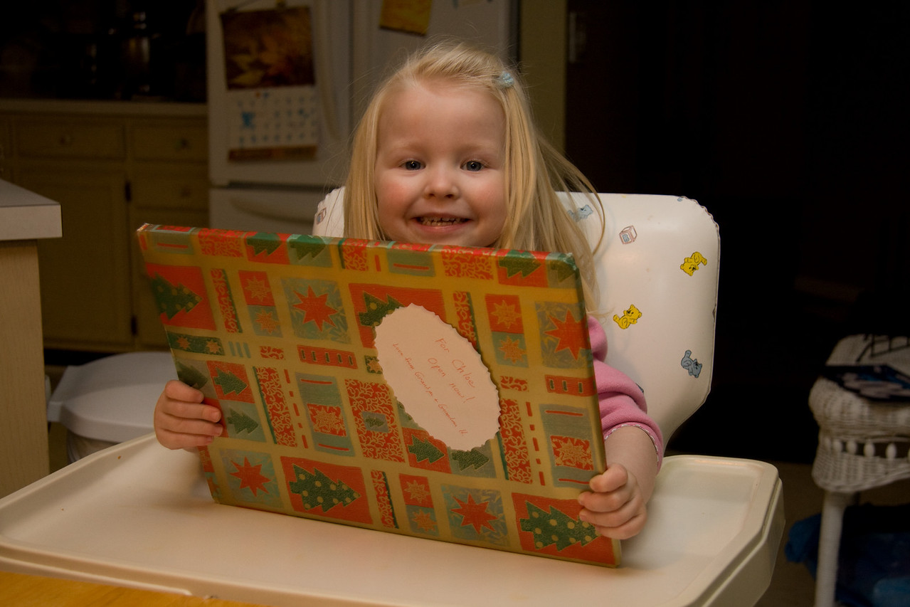 Chloe opens an advent calendar from her grandparents in France, December 2008