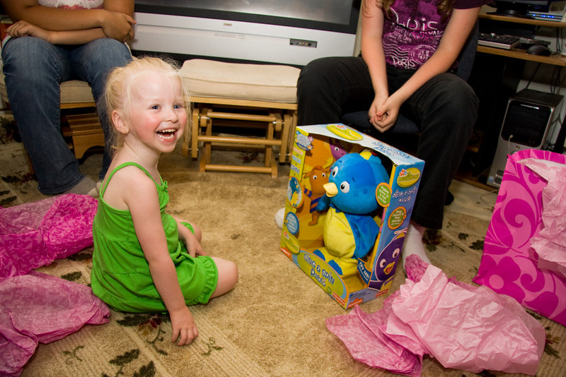 Chloe opens her birthday present from Uncle Peter and Aunt Sara.  Pete had hand-delivered the gift around her actual birthday, but Chloe, for some reason, was too shy to open it.  Today she was thrilled about it.