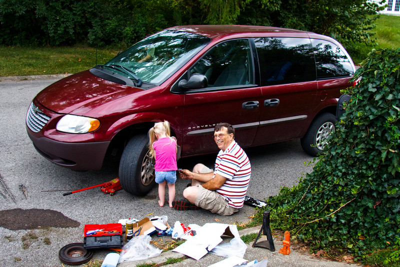 Grandpa changed the brakes on Jenn's van.  And Chloe helped! - August 2009