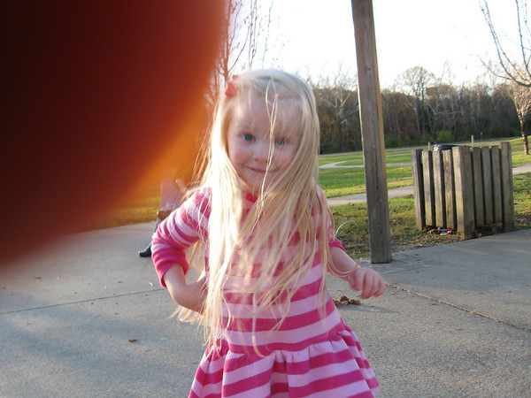 And her new little friend took this picture of Chloe...love the finger on the lens...LOL
