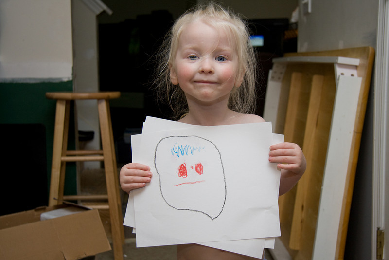 May 24th 2009 - Chloe's drawing of a face.  Notice the similar smiles.  :-|
