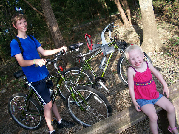 Notice the cool new seat for Chloe on Tim's bike.  Much more fun for both of them than a seat behind Tim.