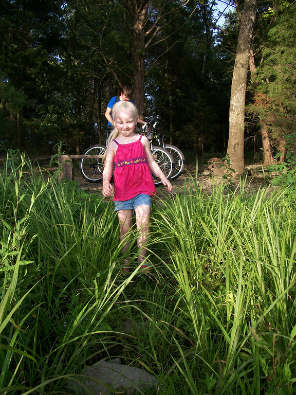 Chloe walks toward the lake.