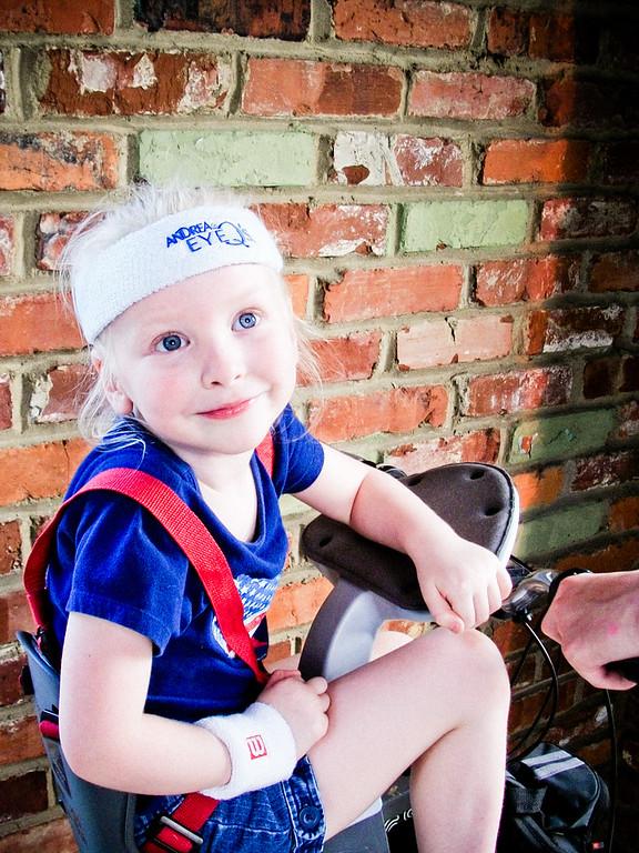 Chloe still fits her bike seat - if she doesn't wear shoes.