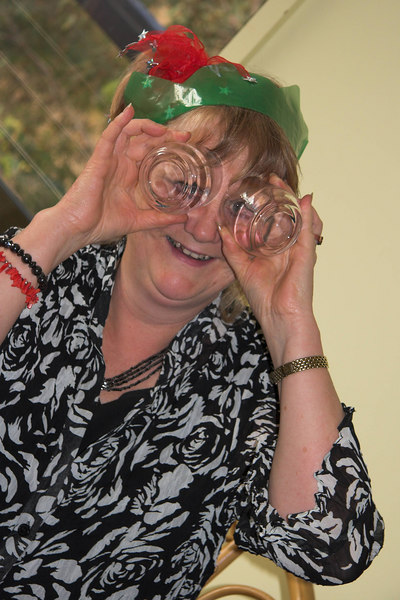 As lunch progressed, some people got sillier... Joan Wessel tries using drinking glasses for spectacles.