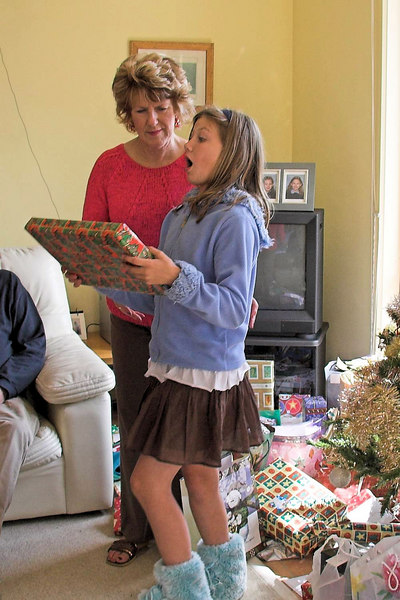 Lynn Tanner and Hayley hand out presents.