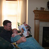 Dan Gill and Olivia Gill read a magazine on the green chair in the livingroom on a lazy afternoon in Hallsville, Missouri on January 8, 2006.