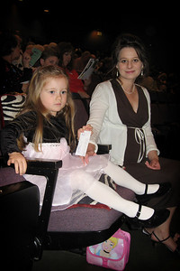 12/10 - Watching a Christmas show in the theatre. Lili loved the dancers, singer and and the live animals on the stage.